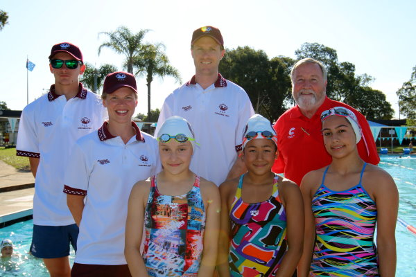 Getting ready to celebrate both the 50th anniversary for both the Merrylands pool and the Merrylands Amateur Swim Club, coach Reece Tomkinson, head club coach Peter Johnston and Cumberland Mayor Greg Cummings with coach Alison Johnston and swimmers Helen Macpherson, Summer Shrestha, and Charlie-Rose El Riachi.